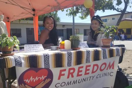 Bernadette Lim seated at a Freedom Community Clinic table.