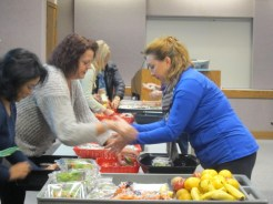 Public Health is working with school nutrition directors--like these shown at a training--to nudge students towards healthier options.
