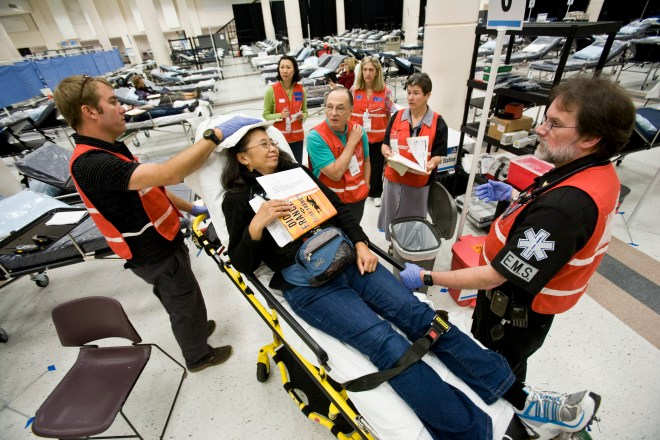 Public Health's Preparedness Section and Public Health Reserve Corps practice setting up a medical facility in case of a catastrophic emergency.