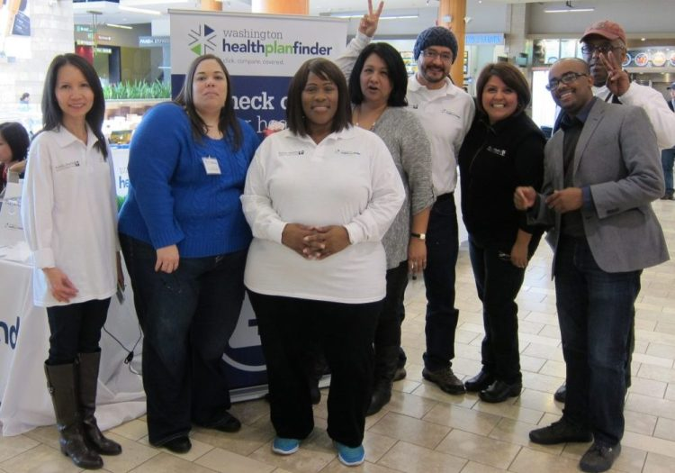 Public Health's enrollment team at Southcenter Mall during previous enrollment season