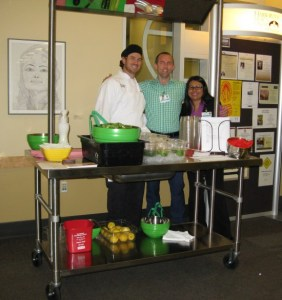 """Staff at Harborview Medical Center used their demonstration table to prepare and give out samples of a """"Green Machine"""" Salad to promote the Oct. 11th Heart Walk."""
