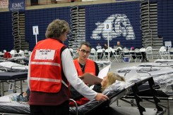 Volunteers in the Public Health Reserve Corps participating in an emergency exercise. They're ready to provide surge support if the healthcare system needs it.