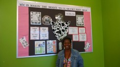 Wynetta Allen of Kent Public Health Center with the bulletin board clinic staff (especially Nancy Lamb) created to educate clients on the upcoming changes to milk in the WIC program