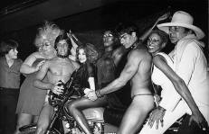 studio-54-musica-divina-grace-jones-monty-rock-the-3rd-with-hat-divines-hand-on-paul-cunliffes-shoulder-go-go-boy-on-the-right-sal-defalco