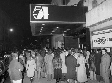 studio-54-officially-opened-its-doors-on-april-16-1977-in-a-building-that-previously-housed-a-theater-the-club-quickly-became-popular-with-regular-crowds-lingering-outside-in-the-hopes-of-getting-in