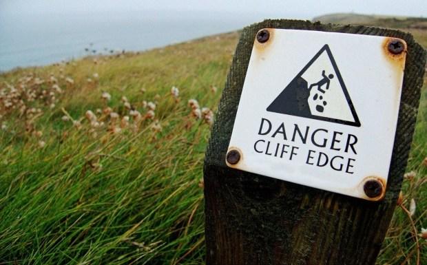 Steep cliff warning sign