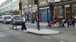 There is no legal requirement to put keep left signs at pelican crossings
