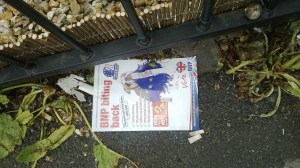 "BNP (British National Party) ""biting back"" poster on the ground in Wythenshawe, UK, May 15, 2014 © Mikey 