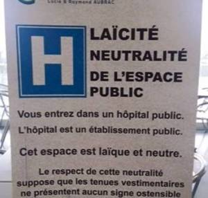 "Public notice posted in a French public hospital stating that due to the ""laïque and neutral"" space of the hospital, anyone wearing an ""ostentatious symbol linked to a religion"" would be denied entry © Alana Lentin"