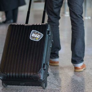 """Buch an Bord"" suitcase sticker (Image: Condor Airlines)"
