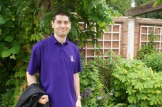 Josh, coordinating cheerfully with the clematis & other purple flowers