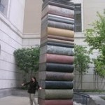 Christina A. Nelson in front of a huge book sculpture