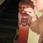 rubbing the wooden lion's nose for good luck