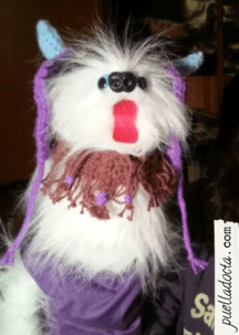 I made her a viking beard and a pair of horns to attach to the purple hat