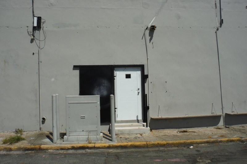 Side entrance on Calle Santa Ana.