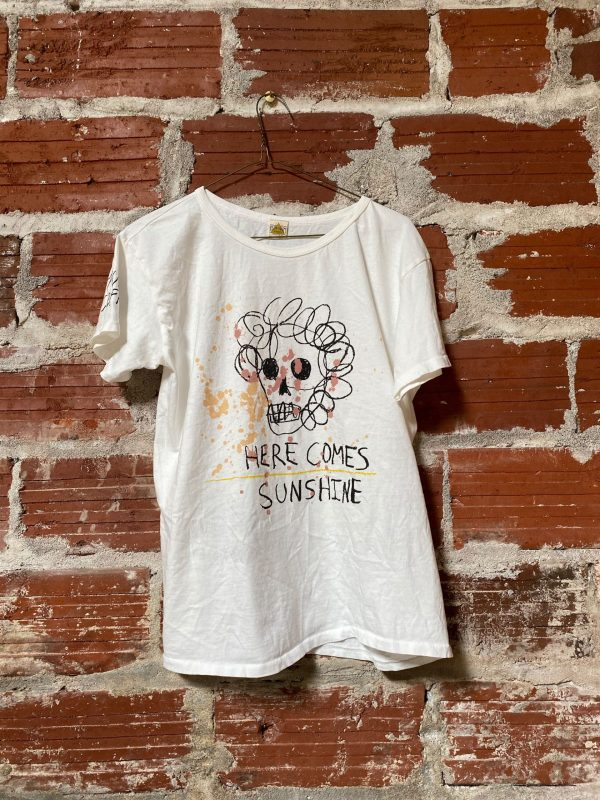 white t-shirt with here comes sunshine graphic