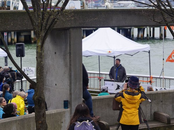 Soundkeeper Chris Wilke speaks at a public rally on the Seattle waterfront.