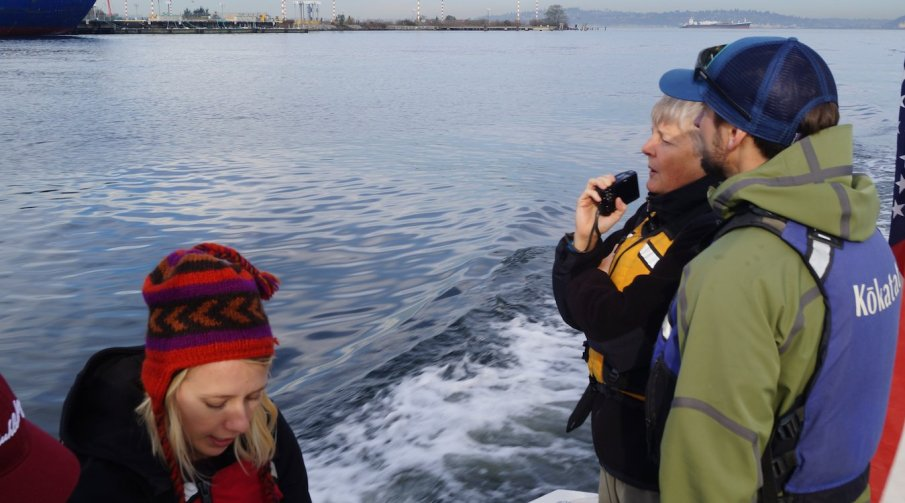 Soundkeeper staff look out at Elliott Bay from the patrol boat on a routine boat patrol.