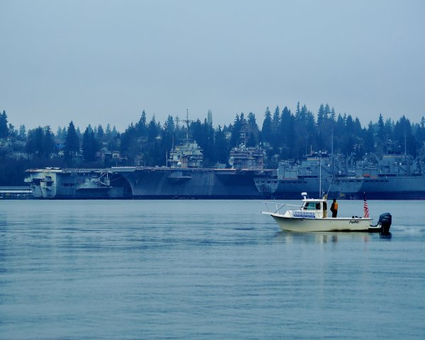 Soundkeeper Patrol Boat looks towards the Bremerton Naval Base and  the USS Independence