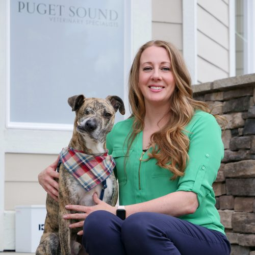 Dr. Boyd and Squish sitting on steps of Puget Sound Veterinary Specialists