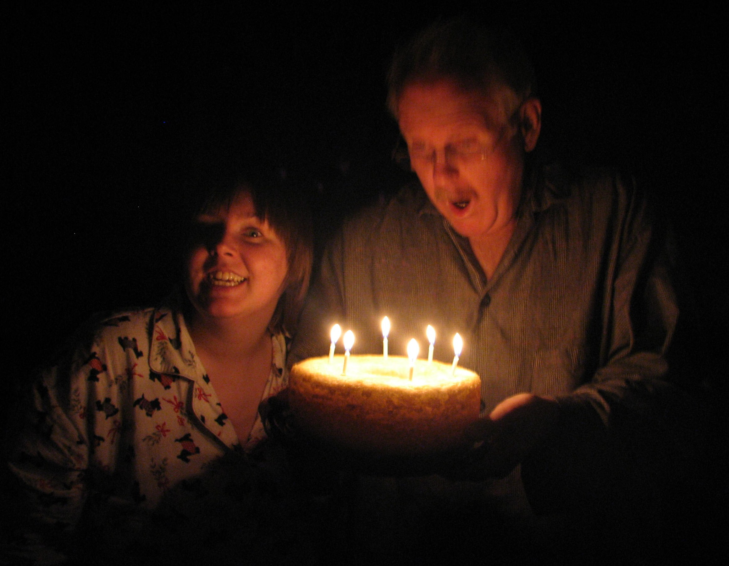 Ann and Papa about to blow out his candles