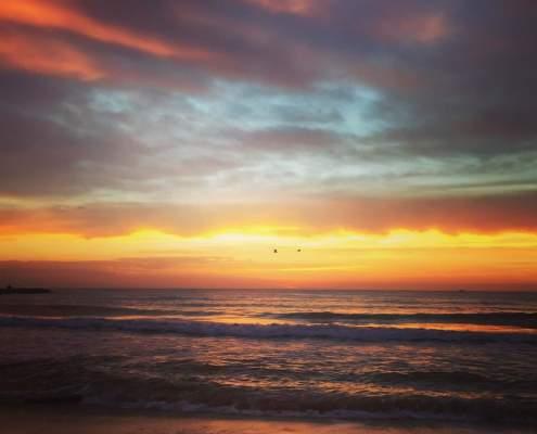Puesta de sol en la playa de Puzol