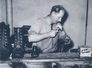 Sy Nowicki repairing shoes in 1942.