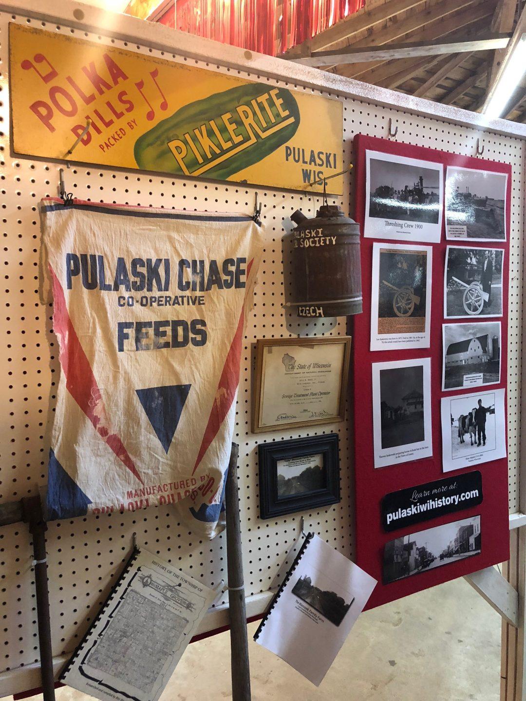 Early farming display at fair.