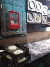 The tins used to store flour and the kitchen working table