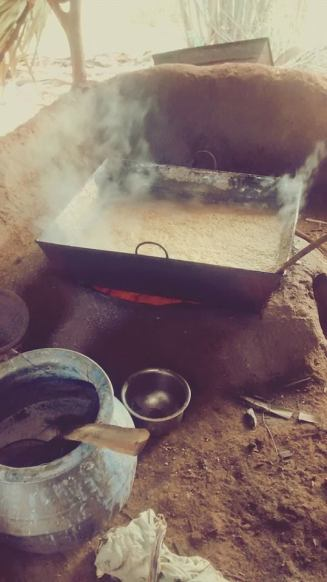 Palm juice being boiled for hours to a syrup consistency.