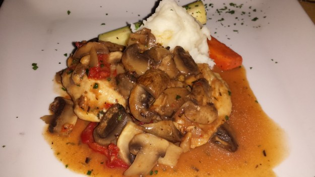 Pollo Saporito- Chicken sauteed with mushroom, pine nuts, sun dried and fresh tomatoes over pureed potatoes