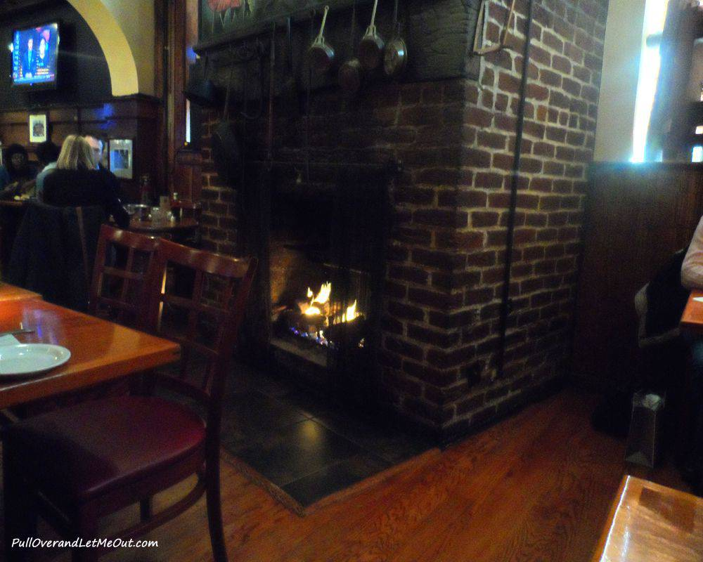 Dining by a crackling fire.