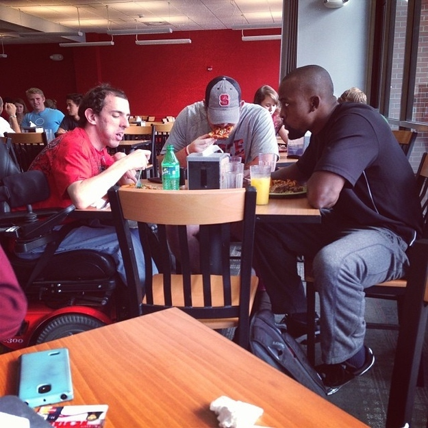 This picture of two football players who didn't want this student to eat alone.