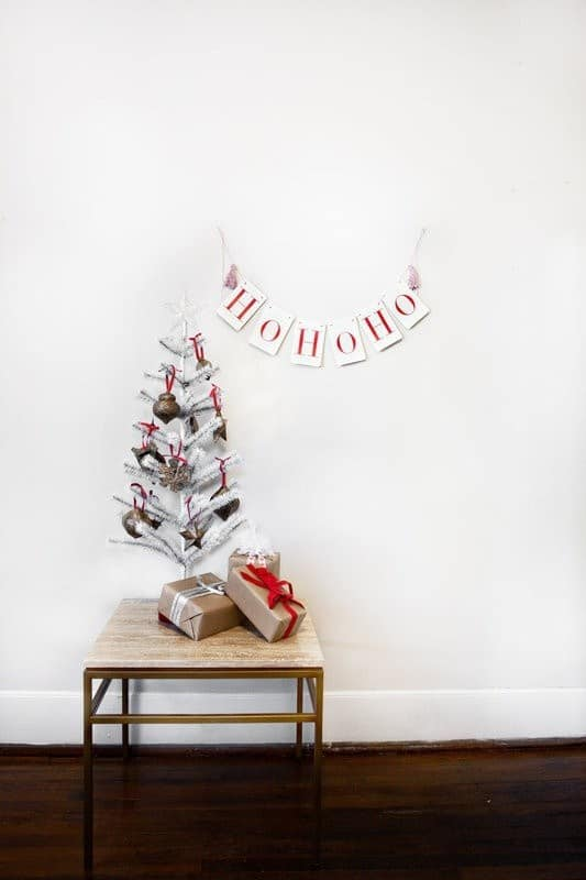 2 this charming silver tree with its rustic ornaments effortlessly give life to a plain room