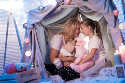Mother and Daughter in a blanket fort