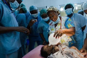 A nurse created an improvised pacifier from a sterile glove to soothe a baby awaiting surgery for a cleft lip at the Komfo Anokye Teaching Hospital (KATH) in Kumasi, Ghana in May 2014. Medical professionals from across the African continent had come together with a team from Seattle Children's Hospital as part of an ongoing initiative to improve cleft lip and cleft palate treatment capabilities on the continent.