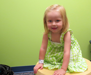 Ada Zeitz, 2, tries to have some fun at her Kidney Stones Clinic visit while her mom and dad meet with the multidisciplinary team.