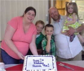 The Campbell family celebrating Hannah's second birthday