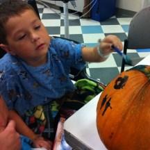 Kid Painting Pumpkin