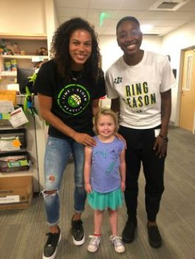 Clark, Loyd and Lucy pose for a photo at Seattle Children's.
