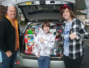 Travis, Turner and Tynan Patterson (from left to right) packed the car for last year's toy drive for Children's.