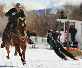 Hunter skijoring, which is when a skier is pulled by a horse.