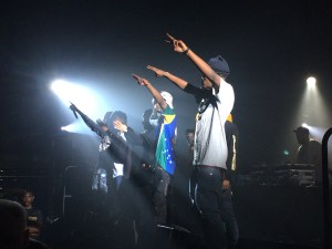 Joey and other members of Pro Era hold up two fingers in tribute to one of their members, Capital STEEZ.