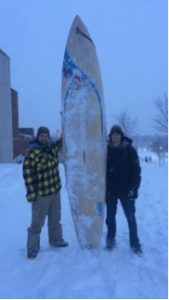 Lindsey Feingold/Pulsefeedz Adam Killian (left) and John Huntzinger (right) posing with their surfboard