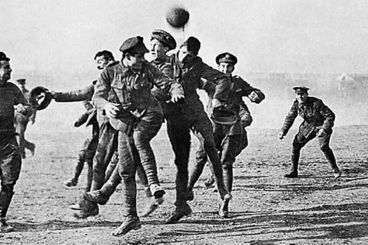 German and British soldiers play football in No Man's Land. Courtesy: www.flanderstoday.eu
