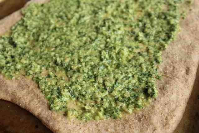 "Crispy Kale Pesto Pizza with Cashew ""Ricotta"""