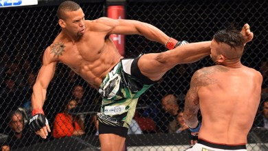 HOLLYWOOD, FL - JUNE 27: (L-R) Thiago Santos of Brazil lands a kick to the head of Steve Bosse of Canada in their middleweight during the UFC Fight Night event at the Hard Rock Live on June 27, 2015 in Hollywood, Florida. (Photo by Josh Hedges/Zuffa LLC/Zuffa LLC via Getty Images)