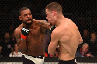 ORLANDO, FL - DECEMBER 19: (L-R) Michael Johnson punches Nate Diaz in their lightweight bout during the UFC Fight Night event at the Amway Center on December 19, 2015 in Orlando, Florida. (Photo by Josh Hedges/Zuffa LLC/Zuffa LLC via Getty Images)
