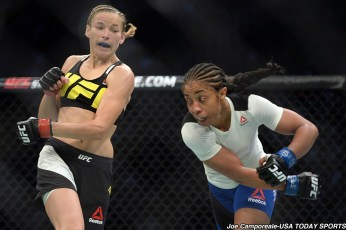 Aug 6, 2016; Salt Lake City, UT, USA; Maryna Moroz (red gloves) and Danielle Taylor (blue gloves) fight during UFC Fight Night at Vivint Smart Home Arena. Moroz won via unanimous decision. Mandatory Credit: Joe Camporeale-USA TODAY Sports