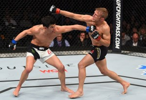 BOSTON, MA - JANUARY 17: (R-L) TJ Dillashaw and Dominick Cruz trade punches in their UFC bantamweight championship bout during the UFC Fight Night event inside TD Garden on January 17, 2016 in Boston, Massachusetts. (Photo by Jeff Bottari/Zuffa LLC/Zuffa LLC via Getty Images)